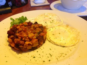 Eggs over-easy with sweet potato and andouille hash